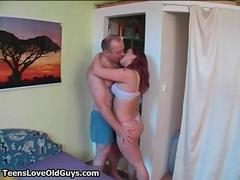 Busty redhead is fucked by..
